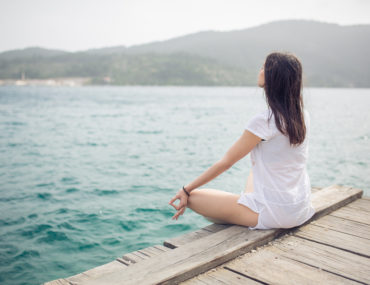 mindfulness conceptual image of a woman by the water